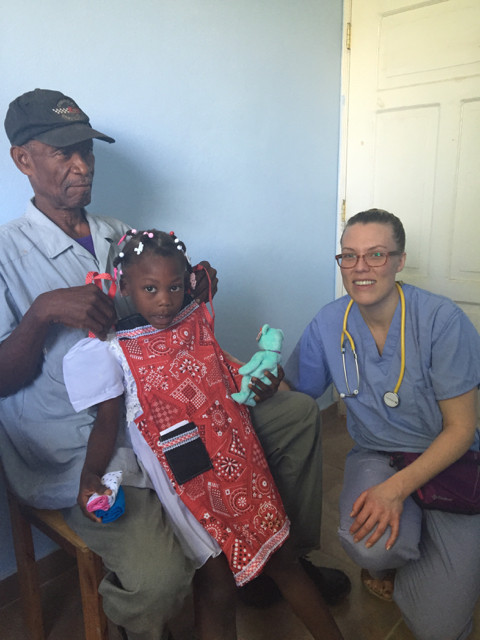 Here is Joy giving a dress and Beanie baby to a young girl who came to the clinic with her Grandpa.