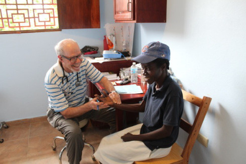 Greg VonRoenn checks the pulse on one of the clinic patients.