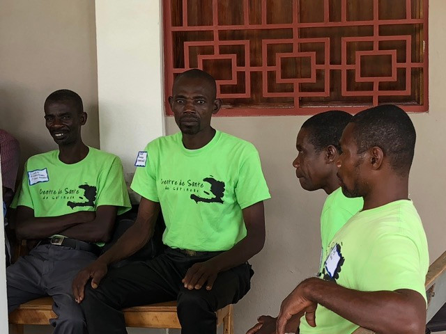 Ceneus Pierre (left) says latrines were something he never thought he'd see in his community.