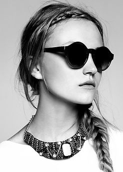 Model in round sunglasses