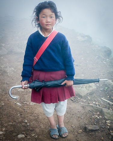Girl with umbrela in fog in Nepal