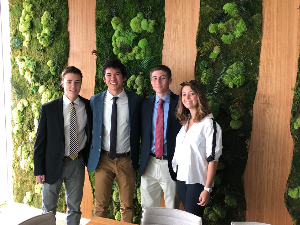 Filip, Nick, Nick, and Niki in one of JLL's conference rooms