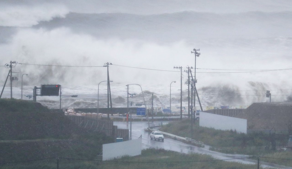Waves crash against a coast in Ishinomaki, Miyagi prefecture, northeastern Japan, Tuesday, Aug. 30, 2016. A typhoon is about to barrel into northern Japan, threatening to bring floods to an area still recovering from the 2011 tsunami. Typhoon Lionrock has already paralyzed traffic, caused blackouts and prompted officials to urge residents to evacuate.(Jun Hirata/Kyodo News via AP)