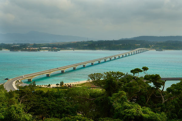 Okinawa, Japan is like living in a seaworld. This bridge take you over coral reefs with thousands of colorful fishes.