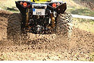 riding an atv on a track