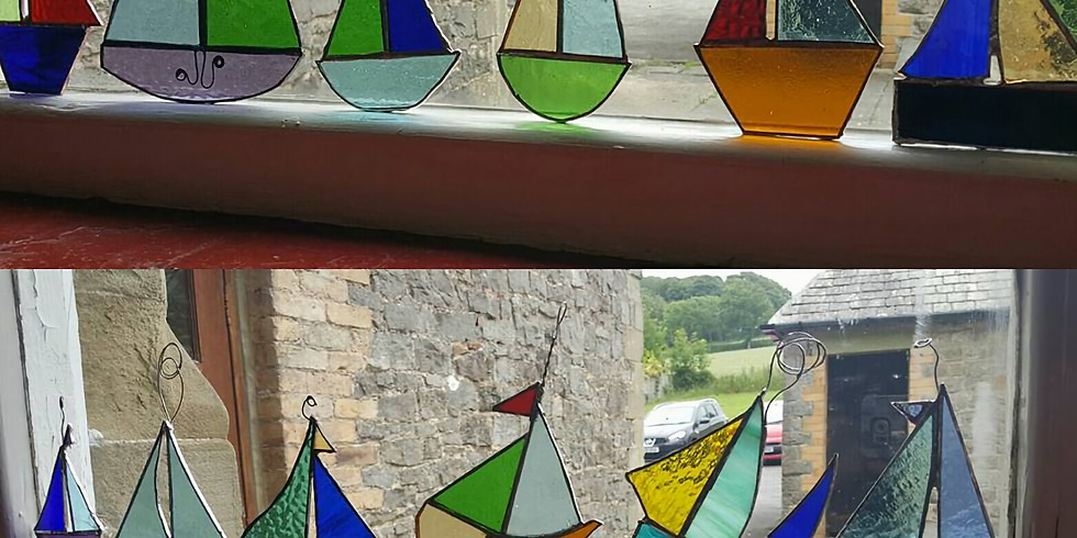 Stained glass boat and dolphin light catchers