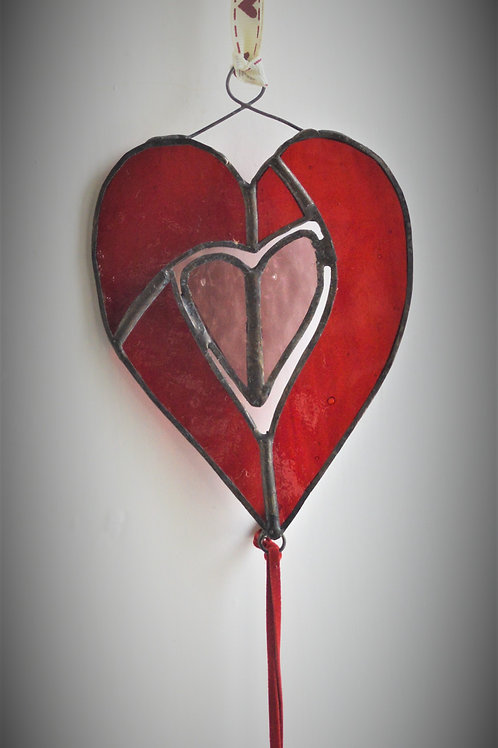 Heart with closed heart within, and hanging heart beneath