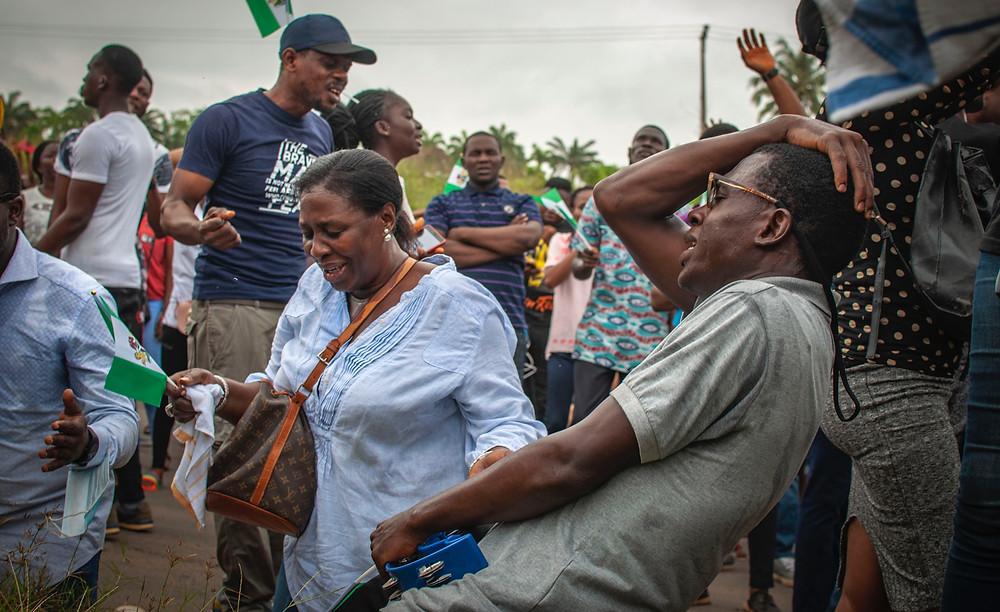 Nigerian Festival Groups People Outside Man Overwhelmed
