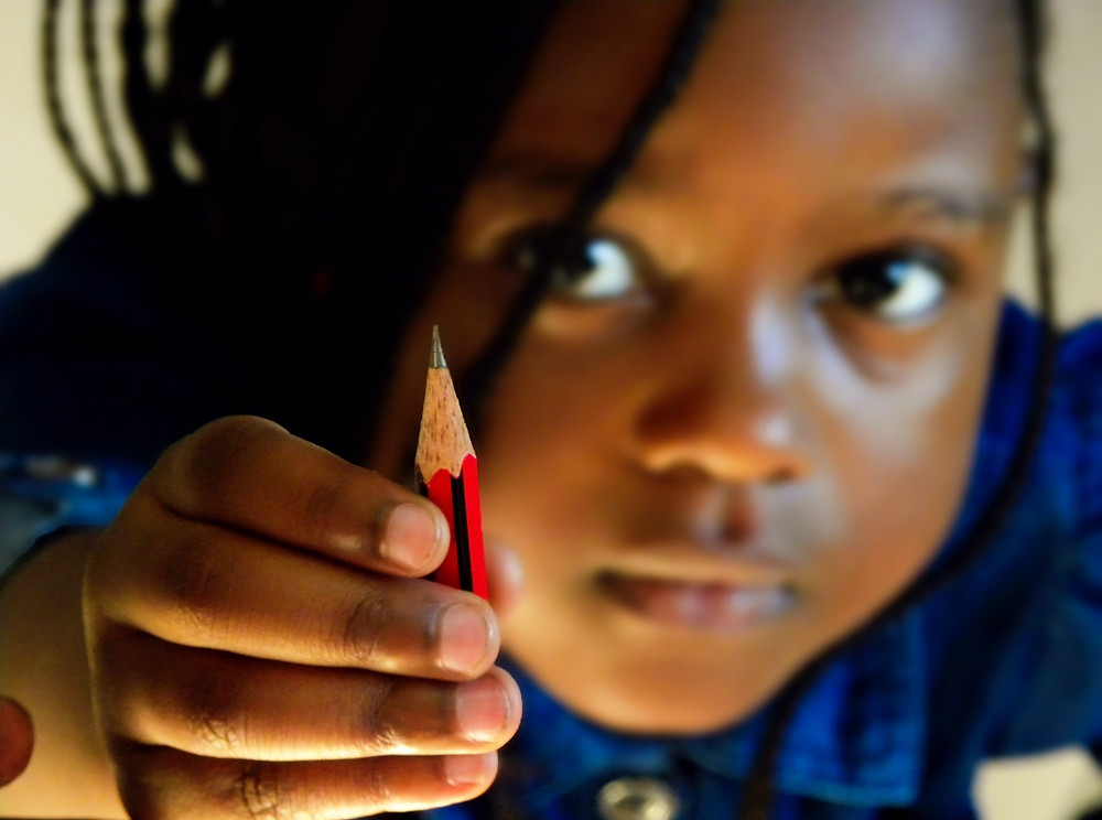 African Child Student Red Pencil Blue Shirt