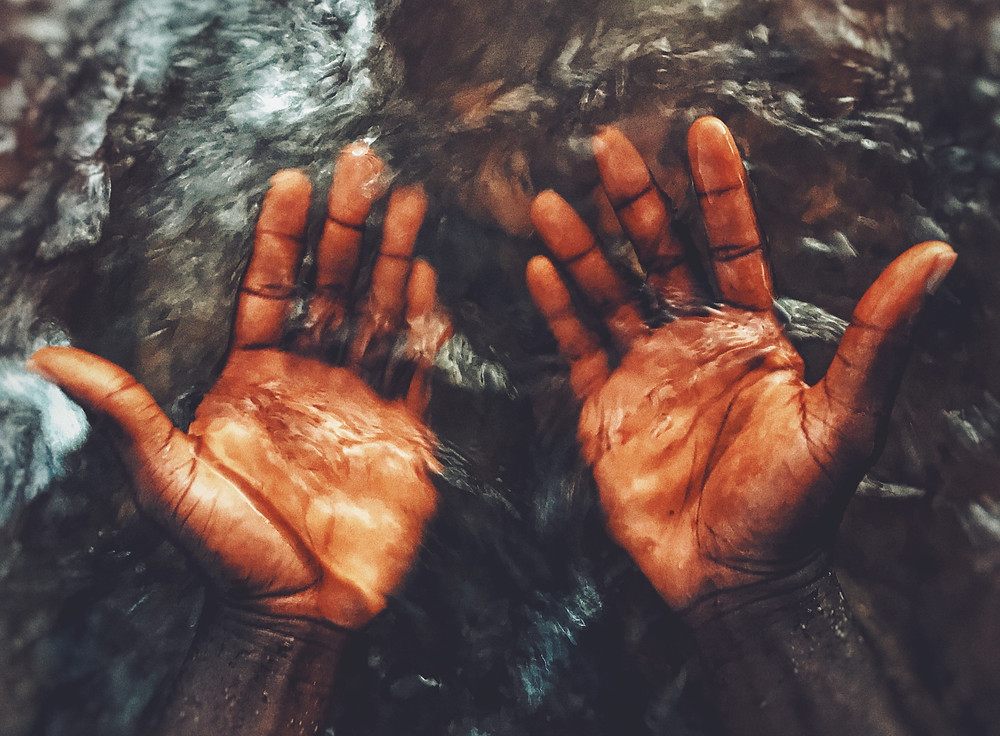 Black Male Wet Hands Palm Up Water River Creek