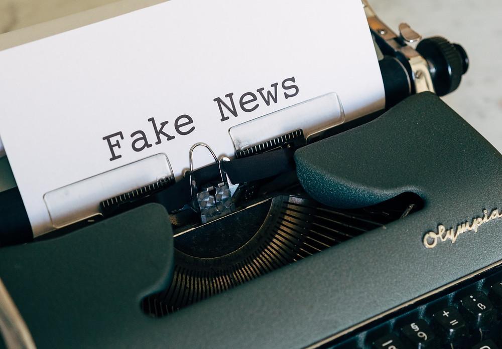 Typewriter Green Olympia White Paper Fake News Print