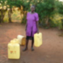 CTCU Woman with Jerry Cans 600 px.jpg