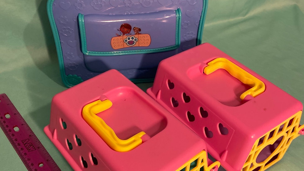 2 Pet carriers and doc McStuffins carrying case