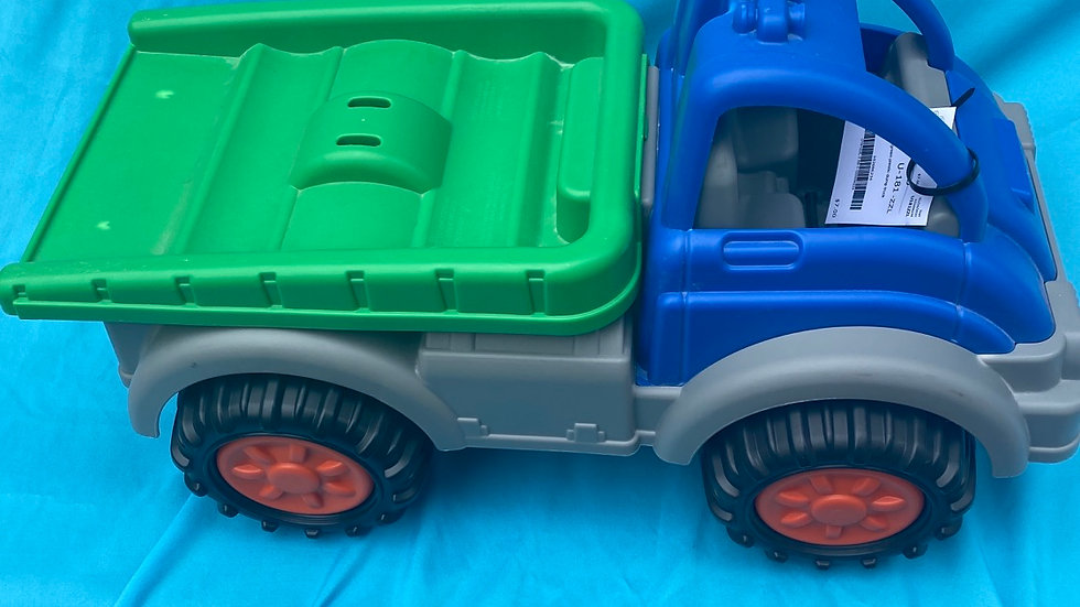 Blue and green plastic dump truck outdoor