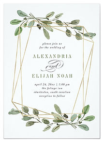 A stylish, minimalist wedding invitation with a gold geometric shape and watercolor green leaves and foliage.