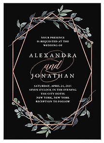 An elegant, dramatic black wedding invitation with a rose gold geometric design and watercolor foliage and greenery.