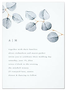 Simple and minimalist watercolor eucalyptus leaves decorate this botanical wedding invitation.
