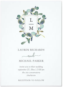 This simple and stylish wedding invitation features an elegant crest with your monograms, surrounded by watercolor green eucalyptus leaves.