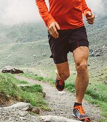 Man_trail_running_in_the_mountain_modifi