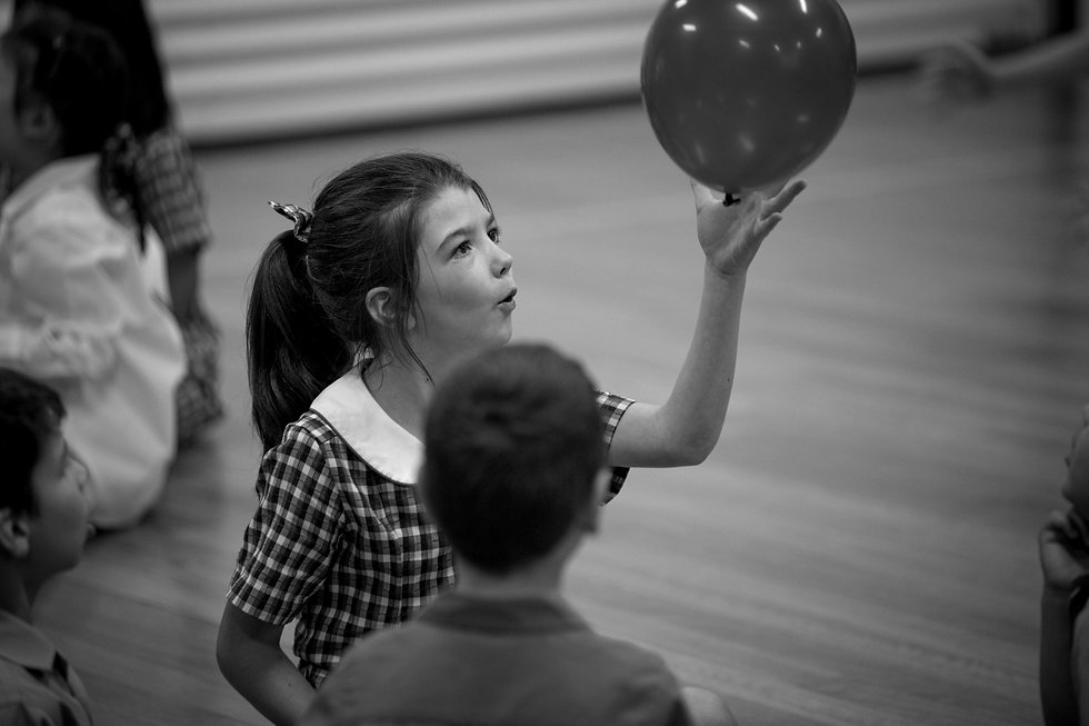 Student playing with a balloon