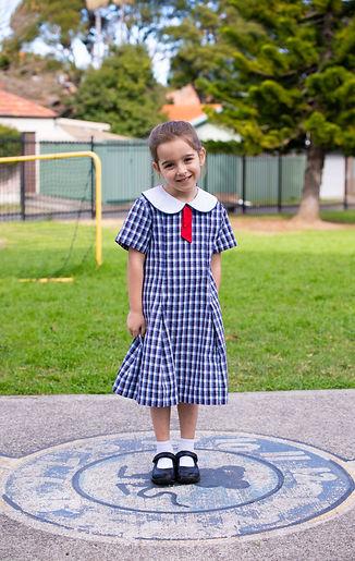Hurstville Grove Infants School student wearing girl's summer uniform