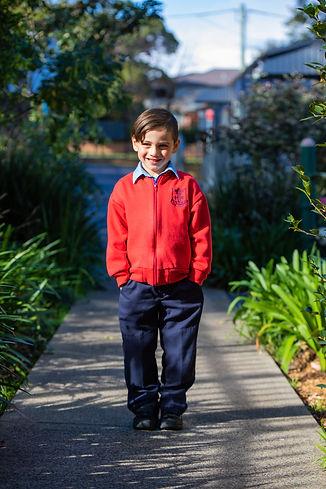 Hurstville Grove Infants School student wearing boy's winter uniform