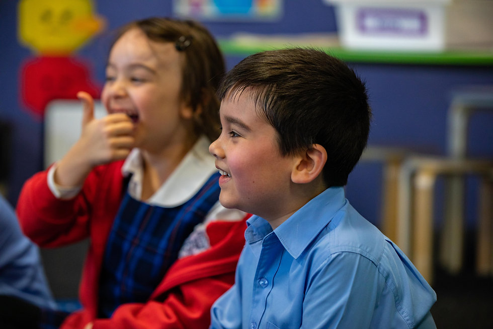 Hurstville Grove Infants School student laughing in class