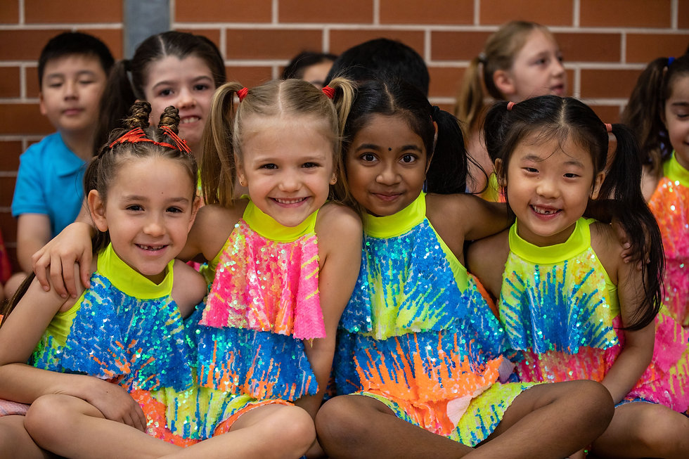 Hurstville Grove Infants School students in their dance costumes smiling at the camera