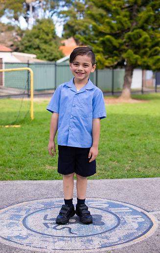 Hurstville Grove Infants School student wearing boy's summer uniform