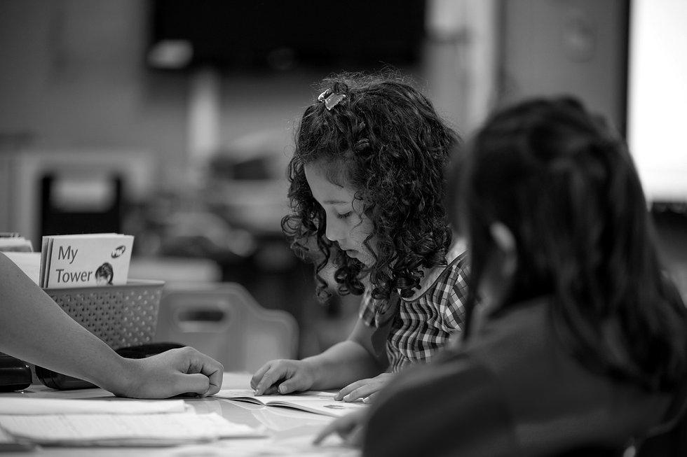 A Hurstville Grove Infants School student reading a book