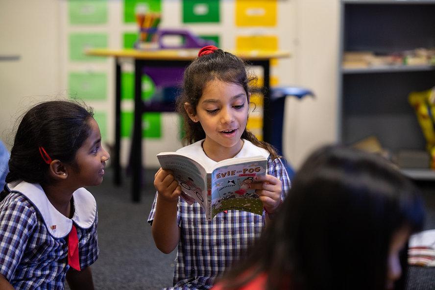 Hurstville Grove Infants School student reading a book