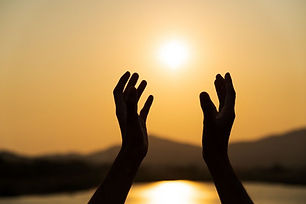 Hands Praying with Sunset.jpg