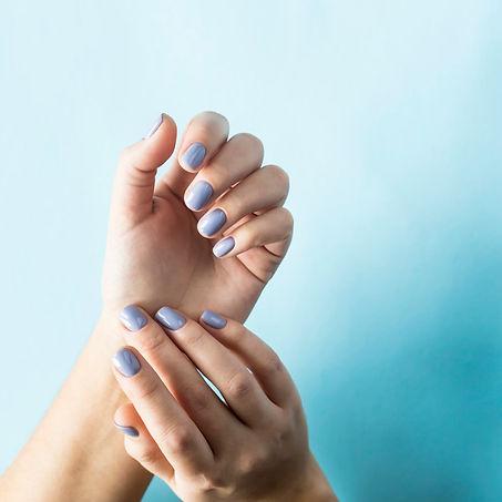 blue-manicure-female-nails-blue-backgrou