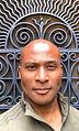 Blasian Man, Black Man, NYC, brick building, street art, graffiti, painting