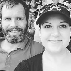 husband and wife, black and white at Atlanta Braves Game