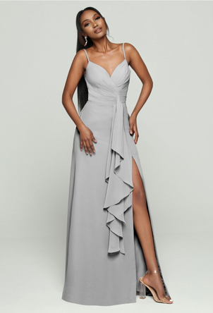 A crossover bodice and asymmetrical skirt create a faux-wrap effect for this A-line dress Come to see the DaVinci #60478 at Madelange Laroche Bridal Studio. Book your appointment here.