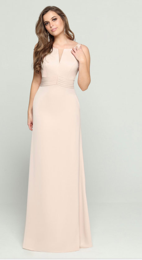 A squared neckline and satin finish bodice accent this chic gown. Come to see the DaVinci #60463 at Madelange Laroche Bridal Studio. Book your appointment here.