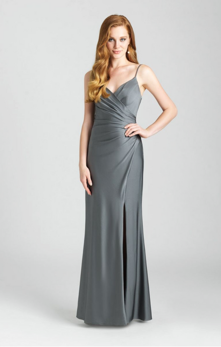 Ruching creates a wrap dress effect along the bodice of this gown. Come to see the Allure 1663 at Madelange Laroche Bridal Studio. Book your appointment here.