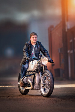 boy in leather and motorcycle