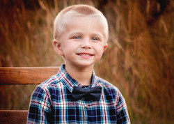 Cute Boy in Bowtie Family Photograph