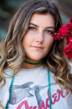 Senior Pictures with red flower