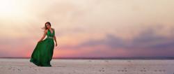 girl in green formal on salt flats