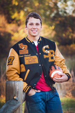 Football Player in Letter Jacket