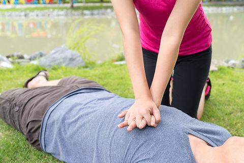 Woman giving cardiopulmonary resuscitati