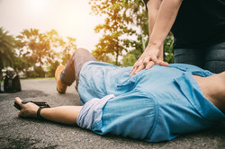 First Aid Emergency CPR on a Man who has