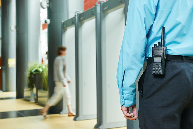 security guard controlling indoor entran