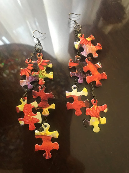 long orange puzzle earrings