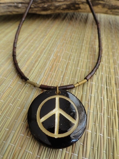 carved bone yin yang pendant on natural wood necklace