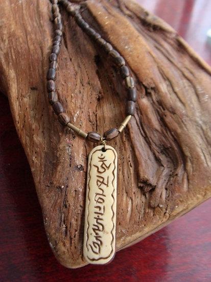 carved bone mantra necklace