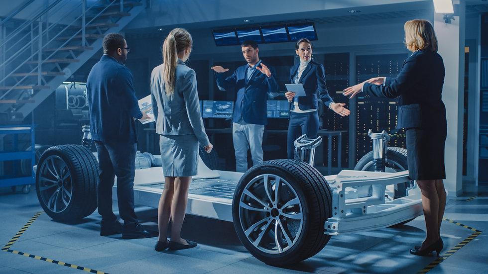 Shot of International Team of Automobile Design Engineers Introducing Futuristic Autonomou